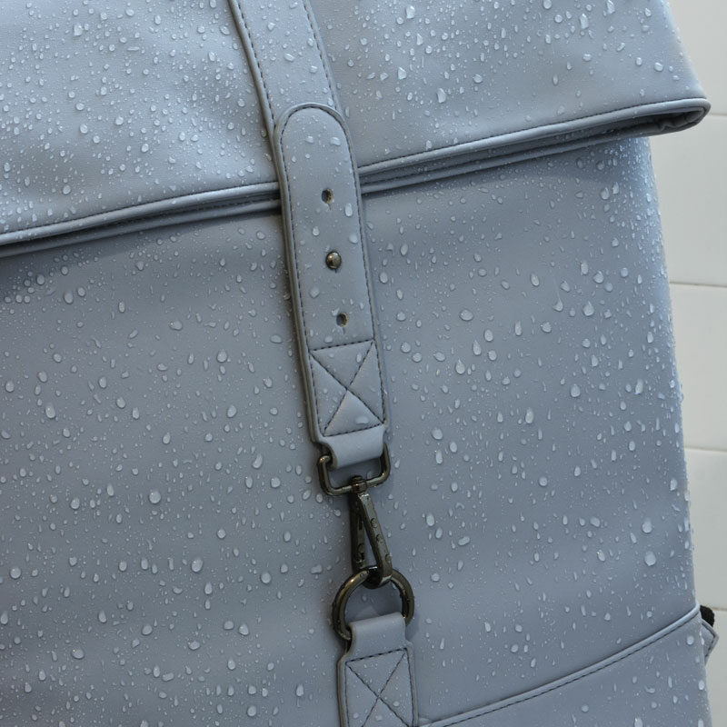Romb Smart Backpack in the shower